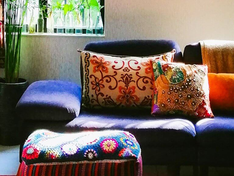 cosy, brightly colored sofa and cushions
